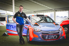Hayden Paddon with the Hyundai AP4 rally car that the successful applicant will drive. Photo / Supplied