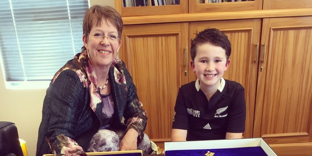 Young Monty Davidson gives Mayor Celia Wade-Brown a new set of chocolate mayoral chains. Photo / Supplied