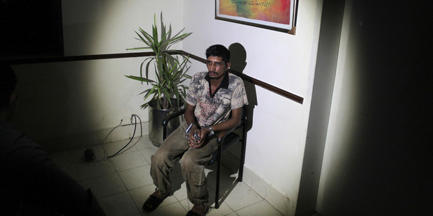 Mubeen Rajhu couldn't stand the teasing, accusations and whispers from co-workers and neighbours that his sister was having an affair and with a Christian. Photo / AP