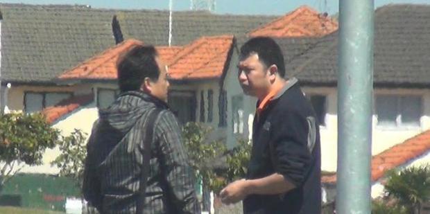 Police surveillance photo of Van Tran (left) meeting Da Wen Shao in a supermarket carpark to hand over a van. Photo / Supplied.