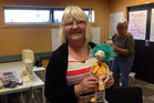 Lynda Tucker displays the doll she made at a workshop with Jill Maas.