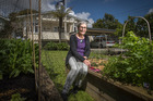 Jennifer Wilson at her Mt Albert home garden that hasn't been to affected by recent rainfall. Photo / Greg Bowker