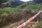 The scene in Taharoa where three bodies were discovered last night. Photo / Alan Gibson