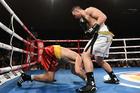 New Zealand heavyweight boxer Joseph Parker knocks down Russia's Alexander Dimitrenko. Photo / Andrew Cornaga.