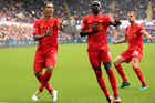 Liverpool's Roberto Firmino, left, celebrates scoring his side's first goal of the game with Sadio Mane, centre, against Swansea City. Photo / AP.
