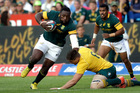 South Africa's Tendai Mtawarira, left, avoids a tackle from Australia's Sean McMahon, bottom, during the Rugby Championship between Sourth Africa and Australia. Photo / AP.