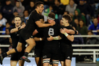 New Zealand's All Blacks players celebrate a try by TJ Perenara during a rugby championship match against Argentina's Pumas, in Buenos Aires. Photo / AP.