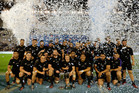 All Blacks team celebrate with the trophy after winning the rugby championship in Buenos Aires. Photo / AP