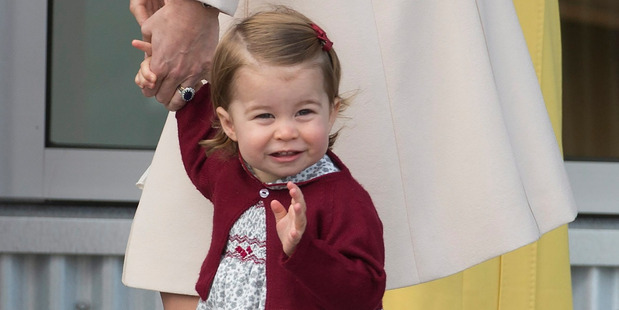 Princess Charlotte waves prior to getting on a float plane as Britain's Royal family prepares to depart Victoria, British Columbia. Photo / AP