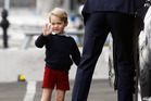 BODY LANGUAGE: Prince George - on a royal tour of Canada with Prince William and Kate - had the analysts interpreting every look and gesture.