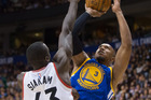 Golden State Warriors' David West, right, shoots over Toronto Raptors' Pascal Siakam during the first half of a preseason NBA basketball game. Photo / AP