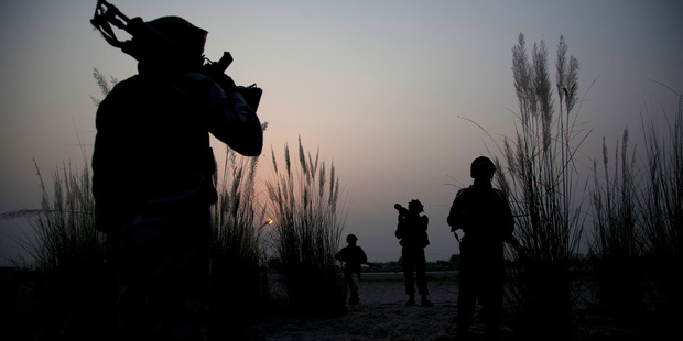 Indian army soldiers patrol near the highly militarized Line of Control dividing Kashmir. Photo / AP