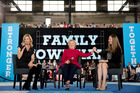 Hillary Clinton, accompanied by her daughter Chelsea Clinton, right, and actress Elizabeth Banks, attends a town hall meeting. Photo / AP