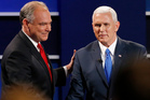 Republican vice-presidential nominee Mike Pence, right, and Democratic vice-presidential nominee Tim Kaine shake hands after the vice-presidential debate in Farmville. Photo / AP