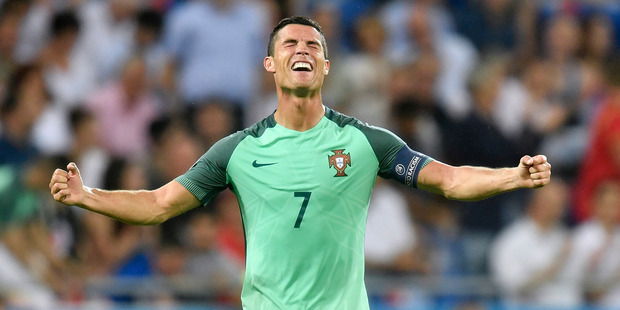 Portugal's Cristiano Ronaldo celebrates at the end of the Euro 2016 semifinal soccer match between Portugal and Wales. Photo / AP