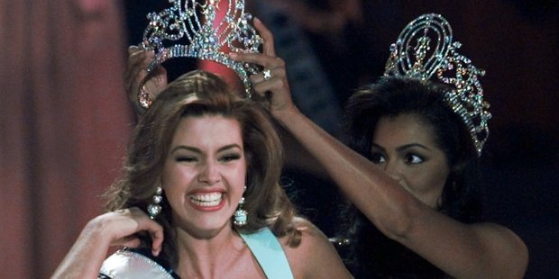 In 1996, the new Miss Universe Alicia Machado of Venezuela reacts as she is crowned by the 1995 winner Chelsi Smith. File photo / AP