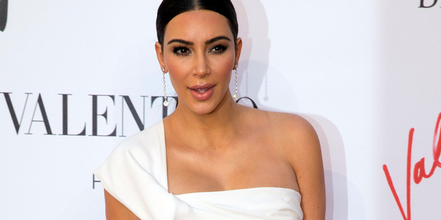 """Loading Kim Kardashian, who is in the city for Paris Fashion Week, is """"badly shaken but physically unharmed"""". Photo / AP"""
