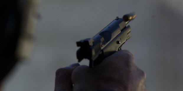 Firing a pistol at a shooting range. Photo/File