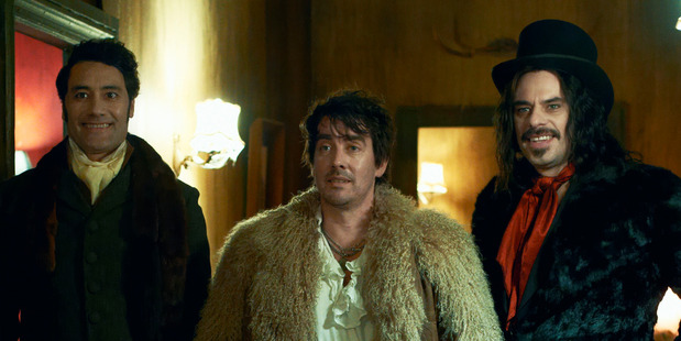 A scene from the movie, What we Do in the Shadows, starring Taika Waititi, Jonathon Brugh and Jemaine Clement.