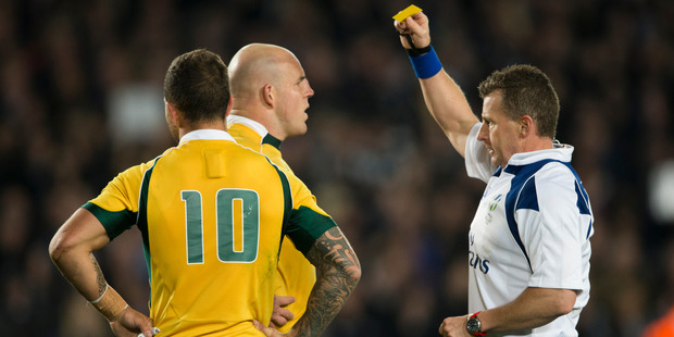 Nigel Owens shows a yellow card to Wallabies captain Stephen Moore. Photo / Greg Bowker
