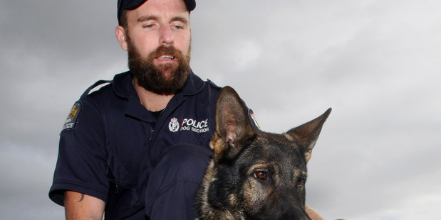 Constable Cam Gunn and police dog, Chuck, were part of the team which caught burglars in the act during the weekend. PHOTO/FILE