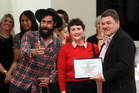 SUCCESS: Brad Gamble and Hapi naturopath Fleur du Fresne receive an award from Richard Chandler from Resene at the Napier City Awards last month. PHOTO FILE
