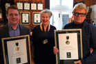 Matt Kirby, left, Helma van den Berg and Tim Turvey with Clearview's trophy awards for its Reserve Chardonnay 2015.