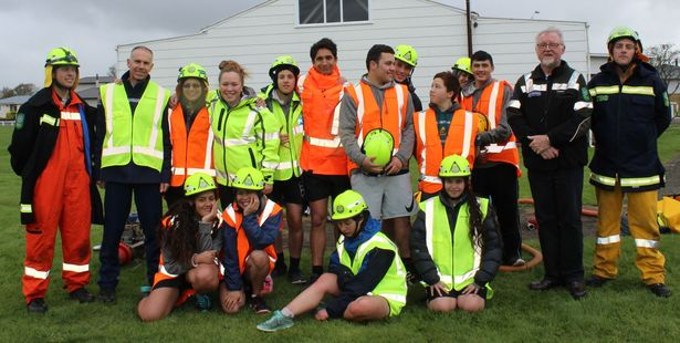 Dannevirke Cactus students, with Senior Constable Wayne Churchouse (second from left) and Paddy Driver, the Tararua District resilience manager, during their fire-fighting exercises at the Domain last Monday afternoon. Photo / Christine McKay