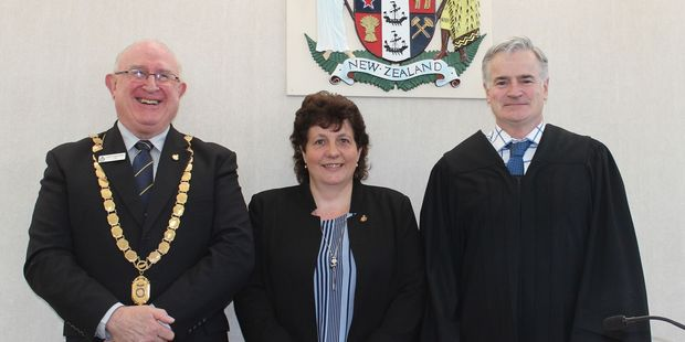 Sworn in: Joe Hollander, JP, president of the Royal Federation of Justices for the Central Districts, left, new Justice of the Peace, Katrina Kerr and Judge Gerard Lynch in the Dannevirke Court House.