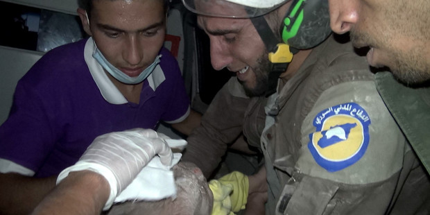 In video footage that broke hearts around the world, four-month-old Wahida made the rescue worker who carried her out of the rubble in Syria's Idlib break down in tears. Photo / Getty Images