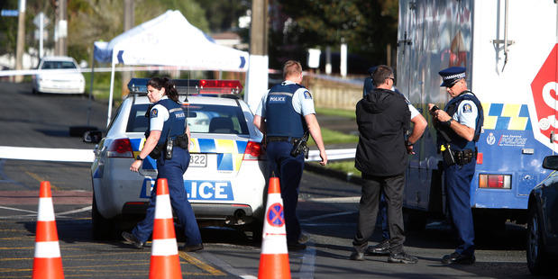 Police on the cordon at William Jones Drive. PHOTO Michael Cunningham