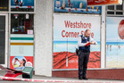 ON SITE: A police officer on the scene of an incident at Westshore Corner Store this afternoon. PHOTO PAUL TAYLOR