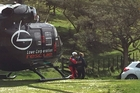 ON HAND: Marie Cresswell being attended to by a crew member of the The Lowe Corporation Rescue Helicopter. PHOTO/SUPPLIED