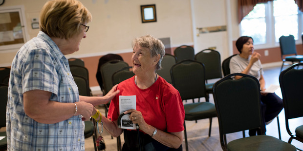 Kathleen McDermott talks to Pastor Pat Deavers at New Hope Fellowship's Sunday service on July 10. Photo / The Washington Post / Sarah L. Voisin
