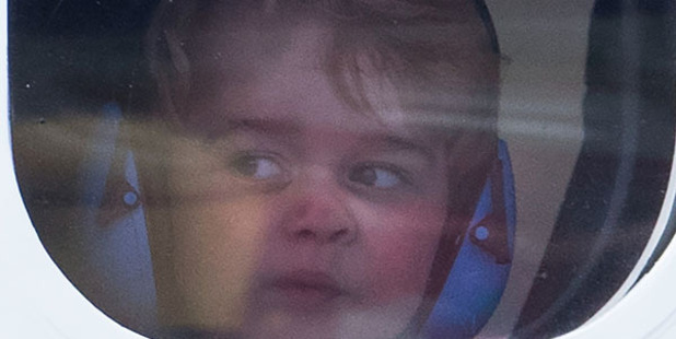 /Prince George of Cambridge looks out of the window of a sea plane as he departs Victoria. Photo / Getty Images