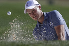 Danny Willett hits out of a bunker during the Ryder Cup. Photo / AP