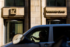 A car passes the Deutsche Bank office in Berlin, Germany. Photo / Bloomberg