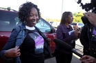 Prince fan Gloria Brown, from Chicago, shows off her custom made Paisley Park Tshirt as she waits to tour Paisley Park. Photo / AP