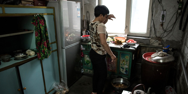 Zhang Tuling in kitchen in Jidong in May. She and her husband say they think contamination of the air and the water from the nearby graphite plant killed their trees. Photo / Michael Robinson Chavez