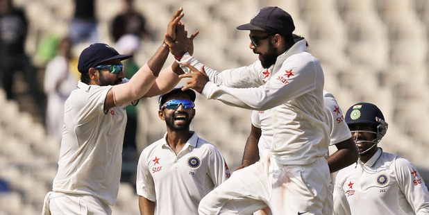 Loading Indian players celebrate the fall of New Zealand's Ross Taylor on the fourth day of the second cricket test. Photo / AP