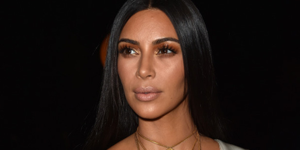 Loading Five masked men bound Kim Kardashian's wrists and ankles before leaving her in the bathtub. Photo / Getty Images