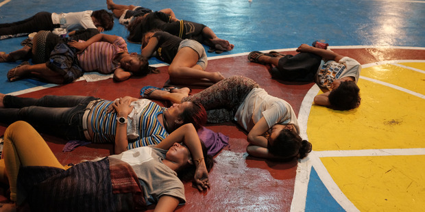 A basketball-court-turned-makeshift-detention-center in Quezon city holds people accused of drug use. Photo / The Washington Post