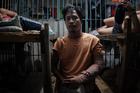 Francisco Santiago Jr., 21, is recuperating from his gunshot wounds while inside a jail cell at the Manila Police Detachment. Photo / The Washington Post