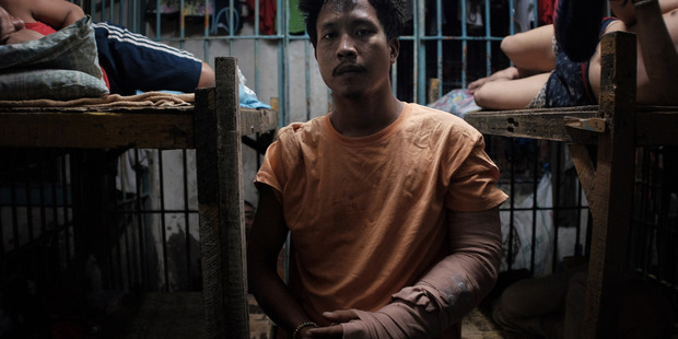 Francisco Santiago jnr, 21, is recuperating while inside a jail cell. The police said that Santiago was selling drugs and was shot during a sting operation. Photo / Washington Post
