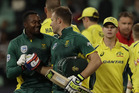 South Africa's batsman Andile Phehlukwayo, left, with teammate David Miller, leaves the field after scoring the winning runs. Photo / AP