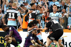 Cronulla players celebrate the club's first ever NRL title. Photo / Photosport