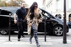 Kim Kardashian pictured with her bodyguard Pascal Duvier. Photo / Splash News