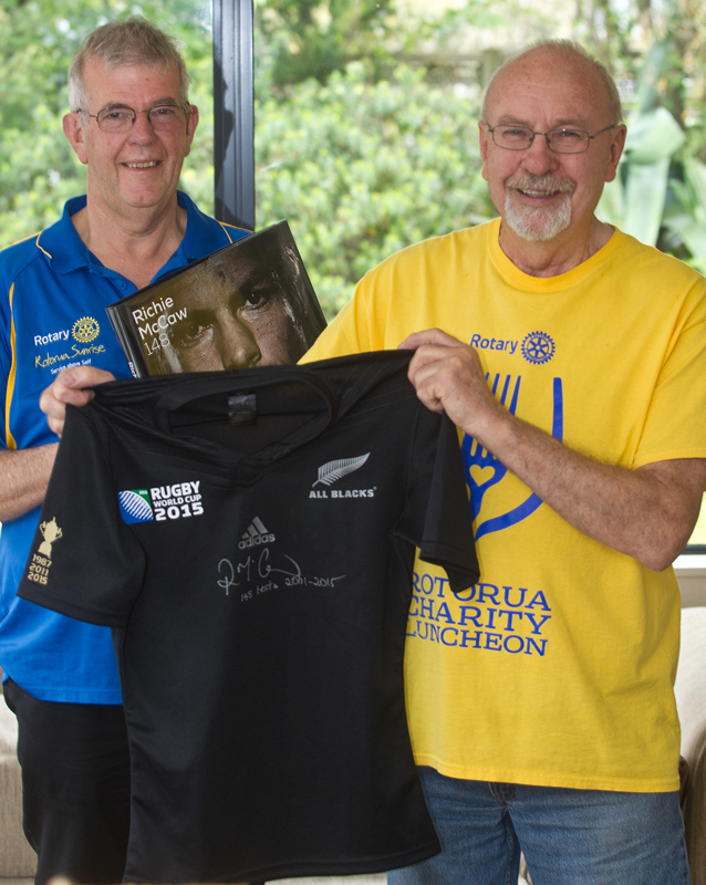 Rotary Rotorua Sunrise member Mike Bannister (left) and Rotorua Charity Luncheon event organiser Don Gollan with the limited edition All Blacks jersey signed by Richie McCaw. PHOTO/STEPHEN PARKER