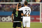 Alan Pulido and Andrew Durante embrace after Mexico's 2-1 win over the All Whites. Photo / photosport.nz