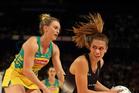 Grace Rasmussen tussle's with Australia's Madi Robinson. Photo / Photosport